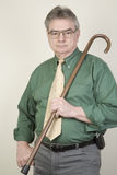 Mature Man with Cane. A mature, well-dressed man holding a cane Royalty Free Stock Photo