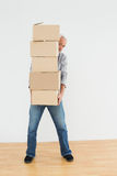 Mature man carrying boxes in a new house Royalty Free Stock Photography