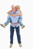 Mature man carrying his partner on his back Royalty Free Stock Photos