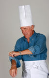 Mature man with chef's hats Stock Photos