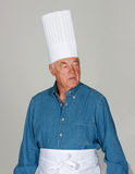 Mature man with chef's hats Royalty Free Stock Photo