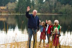 Mature Man with Children Waving Stock Image