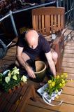 Mature man in city garden Stock Photos
