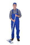 Mature man cleaning floor with mop Stock Photography