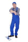 Mature man cleaning floor with mop Royalty Free Stock Photography