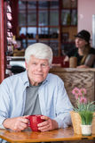 Mature Man in Coffee House Stock Photos