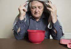Mature man with a cold and sinus issues  inhaling steam Stock Photo