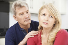 Mature Man Comforting Woman With Depression Royalty Free Stock Image