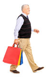 Mature man coming back from shopping Royalty Free Stock Photos