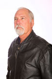 Mature Man. A confident mature man wearing a leather motorcycle jacket stock photography