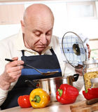 Mature man cooking Royalty Free Stock Image
