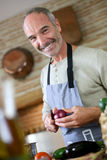 Mature man cooking at home Stock Photo