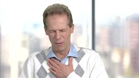 Mature man with cough attack. stock footage