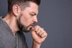 Mature man coughing royalty free stock photos