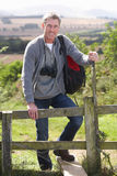 Mature Man On Country Walk Royalty Free Stock Image