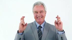 Mature man crossing his fingers stock video