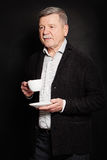 Mature Man with a Cup of Coffee or Tea. Senior Businessman Royalty Free Stock Photos