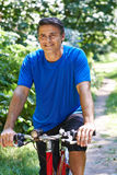 Mature Man Cycling Along Path In Countryside Royalty Free Stock Photos