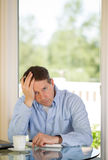 Mature Man depressed while working Royalty Free Stock Photos