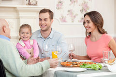 Mature man is dining with his relatives Royalty Free Stock Image