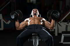 Mature Man Doing Dumbbell Incline Bench Press Workout Stock Image
