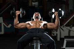 Mature Man Doing Dumbbell Incline Bench Press Workout Stock Photography