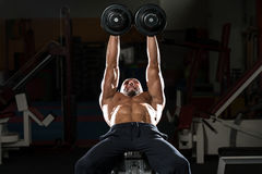 Mature Man Doing Dumbbell Incline Bench Press Workout. Mature Men Doing Dumbbell Incline Bench Press Workout In Gym Stock Photos