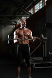 Mature Man Doing Exercise For Biceps Stock Photos