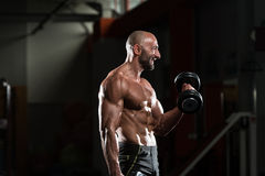 Mature Man Doing Exercise For Biceps Royalty Free Stock Images