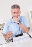Mature Man Doing Finances Royalty Free Stock Photos