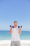 Mature man doing his exercises Royalty Free Stock Image