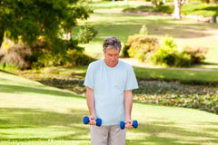 Mature man doing his exercises Royalty Free Stock Photo