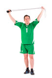 Mature man dressed in green sportswear posing Stock Photography