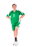 Mature man dressed in green sportswear posing Royalty Free Stock Photo