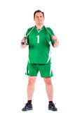 Mature man dressed in green sportswear posing Stock Photos