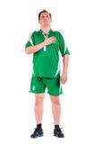 Mature man dressed in green sportswear posing Stock Photo