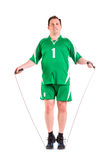 Mature man dressed in green sportswear posing Stock Images