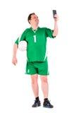 Mature man dressed in green sportswear posing Royalty Free Stock Photos