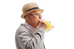 Mature man drinking beer Stock Image
