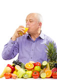 Mature man drinking juice Royalty Free Stock Images