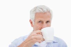 Mature man drinking tea Royalty Free Stock Image