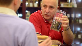 Mature man drinking tea in the cafe Royalty Free Stock Photo
