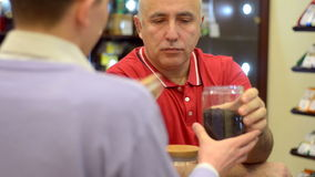 Mature man drinking tea in the cafe Stock Photo
