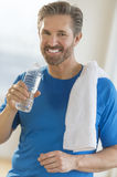 Mature Man Drinking Water After Exercising Royalty Free Stock Image