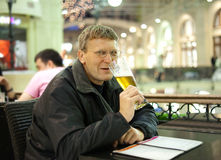 Mature man drinks beer Stock Image