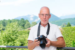 Mature man with dslr camera, outdoors Stock Photo