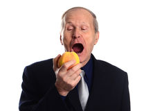 Mature man eating apple isolated on white background Royalty Free Stock Image