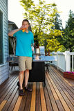Mature Man enjoying a cold beer on nice day outdoors Stock Photography
