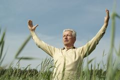 Mature man enjoying on nature Stock Images