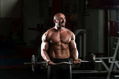 Mature Man Exercise With Barbell Royalty Free Stock Photo